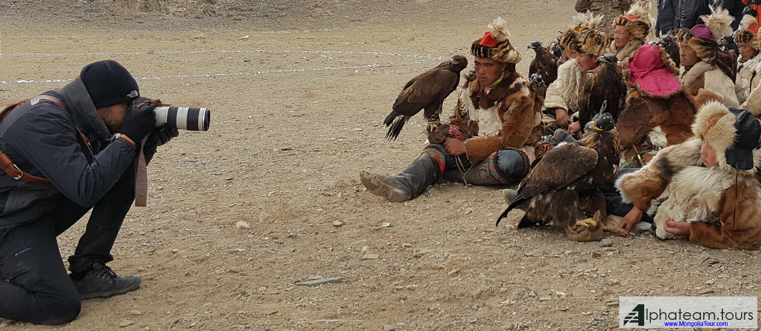 Our customer is going to take photo of the group of Kazakh eagle hunters